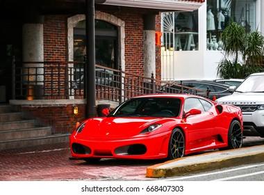 CANCUN, MEXICO - JUNE 4, 2017: Red sportscar Ferrari F430 in the city street.