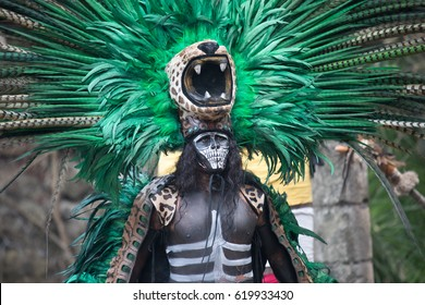 Cancun, Mexico - Mar 16, 2017: Handsome young man dressed in a traditional mayan jaguar costume.