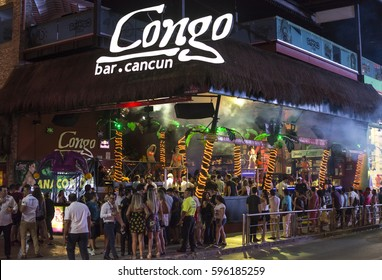 CANCUN, MEXICO - MARCH 1, 2017: The popularity of Cancun as a Spring break destination is partly due to the lively nightlife featuring go-go dancers and open visibility of nightclub interiors.