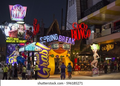 CANCUN, MEXICO - MARCH 1, 2017: Cancun's premiere nightclub, Coco Bongo lights up the night with colorful displays promoting Spring break.