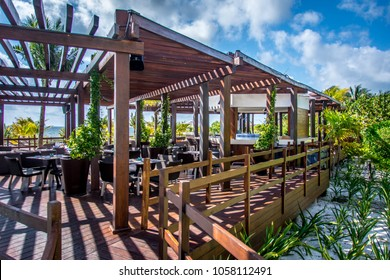 Cancun, Mexico – March 18, 2018: The Beach Club, a bar and restaurant on the beach at the Grand at Moon Palace Cancun, a beautiful tropical Resort and Spa near Cancun, Mexico.