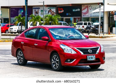 CANCUN, MEXICO - MAY 16, 2017: Motor car Nissan Versa in the city street.