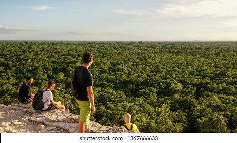 Cancun / Mexico - November 2014: Tourist overlooking the thick jungle on top of the ancient Coba Maya Ruin near Cancun, Yucatan, Mexico.