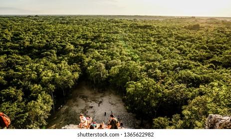 Cancun / Mexico - November 2014: Tourists climbing the ancient Coba Maya Ruin in the thick jungle near Cancun, Yucatan, Mexico.
