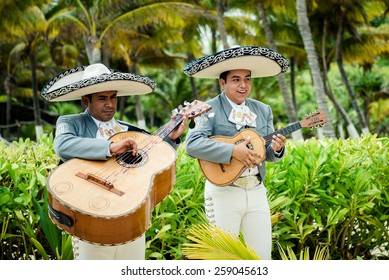 CANCUN, MEXICO â?? SEPTEMBER 1: Mariachi band play Mexican music on 1 of September 2014 at a wedding in Cancun Mexico.