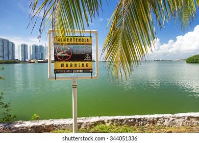 CANCUN, MEXICO - September 25, 2015: Warning crocodiles sign near the Nichupte Lagoon