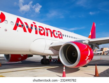 CANCUN - OCTOBER 19: Avianca A-330 disembarking passengers after arriving to Cancun on October 19, 2014 in Cancun, Mexico. Avianca is oldest continiously operating airline.