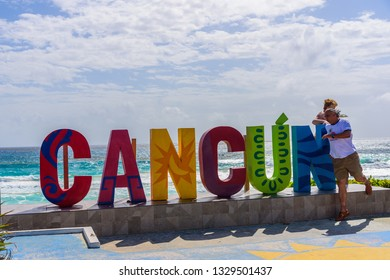 Cancun, Quintana Roo/Mexico - 02 21 2019: Tourists lined up to take photos at the Cancun Sign in Cancun hotel zone