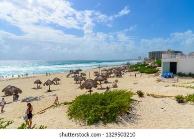 Cancun, Quintana Roo/Mexico - 02 21 2019: Tourists relaxing in Cancun beach