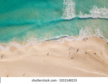 Cancun, Yucatan, Quintana Roo, Mexico, January 17, 2018: Top view of beautiful beach. Aerial drone shot of turquoise sea water at the beach - space for text. Caribbean seaside beach
