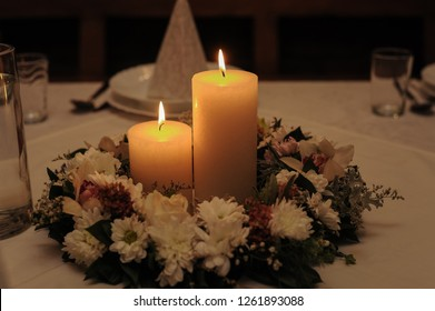 Cande at the table.Flame.Saint in flower.Candle background.Love background.