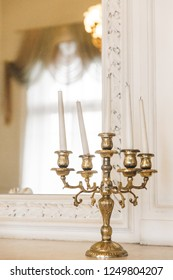 candelabrum candles are on the table