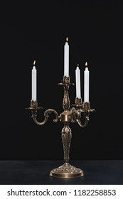 candelabrum with flaming candles on black background