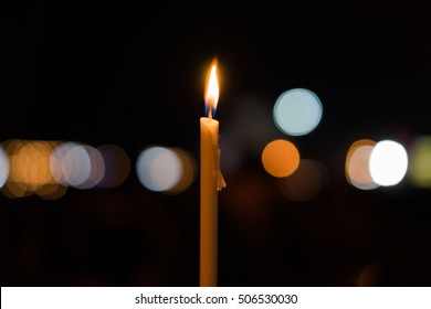A candels with background of dark and bokeh.