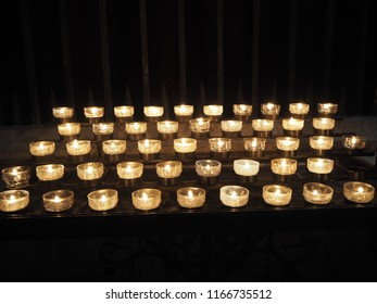 Candels in a church close up with dark background