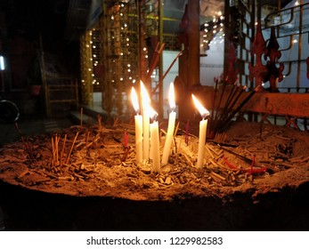 Candels In Front Of A Temple, India