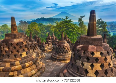 Candi Borobudur in the background of rainforest, morning mist and Sumbing Mountain. Yogyakarta, Jawa, Indonesia.
