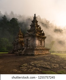 Candi Gedong Songo at sunrise. A 9th-century Buddhist temple complex on a volcano near Semarang, Java, Indonesia.