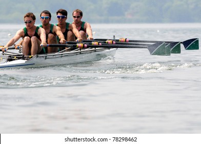 CANDIA, TURIN, ITALY - MAY 22: the CUS Milano quad (quadruple) scull (4x) crew rowing during 2011 Rowing CNU University National Championship on May 22, 2011 on Candia lake, Turin, Italy