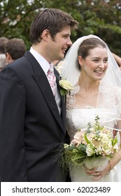 candid image of a happy bride and groom immediately after their wedding ceremony