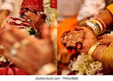 Candid indian wedding images .focus on hands seen together , happy couple .seen beautiful depth of field and colors .