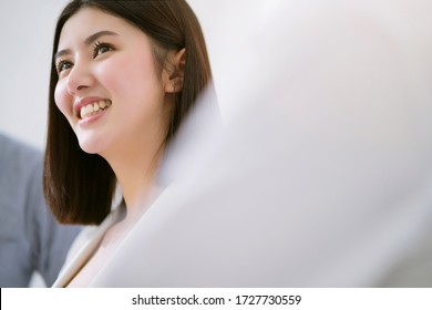 candid portrait asian female businesswoman smile and happiness in successful business meeting business colleague hand applaud  togethewith cheerful and exicted in meeting room modern office background