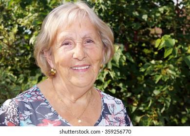 Candid portrait of happy senior woman outside