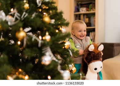 Candid shot of a cheerful kid riding on rocking horse