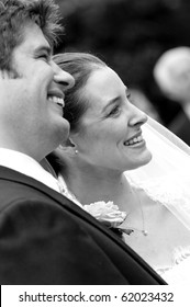 A candid shot of a very happy bride and groom