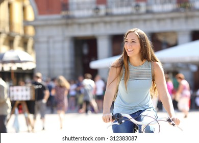 Candid tourist cyclist sightseeing in a old town of a city