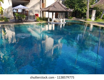 CANDIDASA, BALI, INDONESIA - MAY 17, 2017: Pool amenities in a Candidasa beach resort in Bali, Indonesia, with copy space for travel backgrounds.