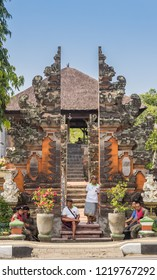 CANDIDASA, INDONESIA - OCTOBER 12, 2018: Indonesian men sitting in front of a temple in Bangli, Bali