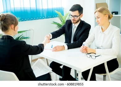 Candidate and an HR manager shake hands