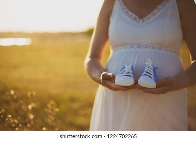 Candidates mother taking her infants shoes