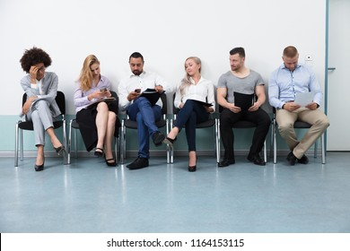 Candidates Sitting On Chair Waiting For An Interview