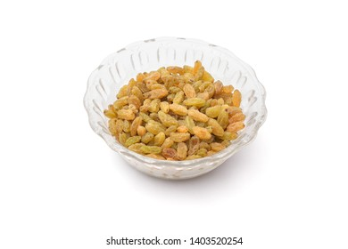 Candied fruit or dried vine fruit of raisins or sultanas in glass bowl isolated on white background,studio shot side view