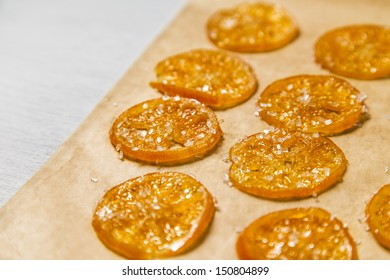 Candied Orange/Clementine Slices on Parchment Paper
