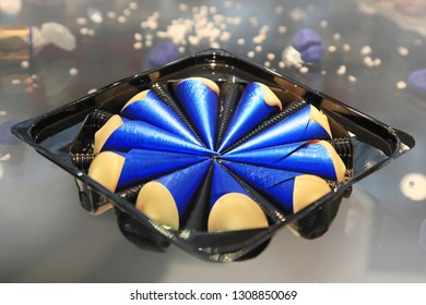 candies in blue metal foil are packed in the form of a cone
