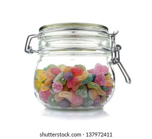 Candies in glass jar , isolated on white