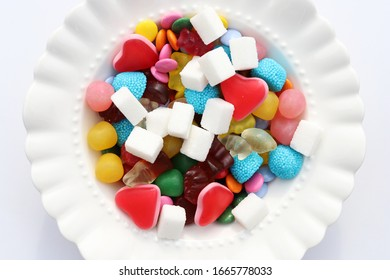 Candies and sugar on a plate. Too much sugar and unhealthy food concept.