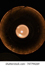 Candle burning casting a auora