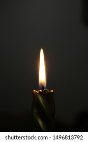 A candle is burning. The darkness disperses. And the flames of breath breathe.