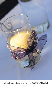Candle center piece with purple ribbon