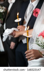 Candle closeup during wedding ceremony in church with selective focus