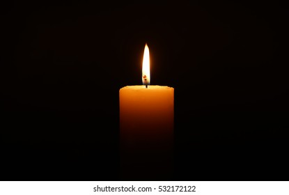 Candle at  the dark background.
