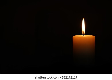 Candle at the dark background.There is a empty place for  writing something.