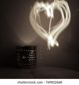 a candle in the dark and patterns with fire