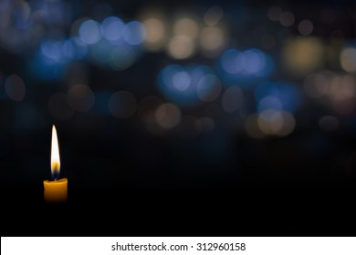 candle flame with abstract bokeh background