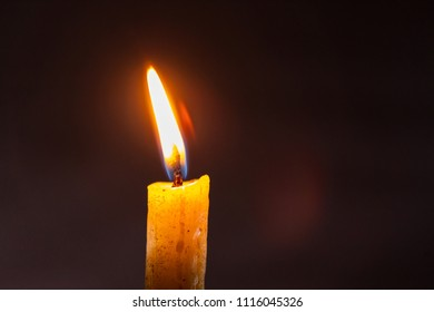 candle flame against black background