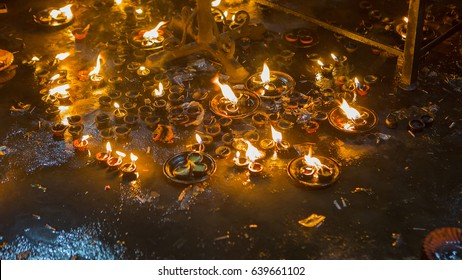 Candle flame close-up in the Indian Temple on a Religious Festival Diwali. Oil Lamp in Thiruvannamalai hindu Temple. Spiritual and Religious Traditions of India. Beautiful bright festive lights